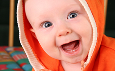 Smile-Baby-Boy-With-Tooth-144X144